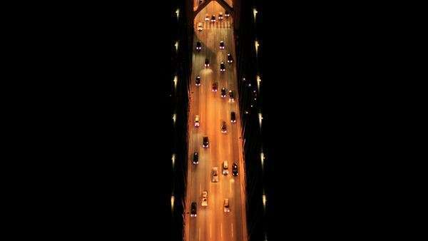 Aerial night vertical view of a five lane illuminated freeway, Oakland Bay Bridge, San Francisco, North America, USA Royalty-free stock video
