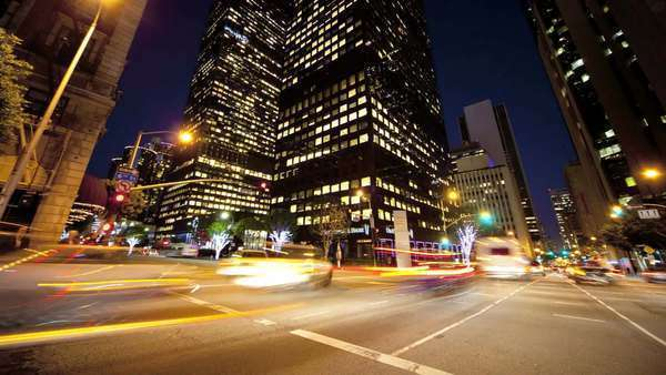 Motion timelapse panning shot city intersection Royalty-free stock video