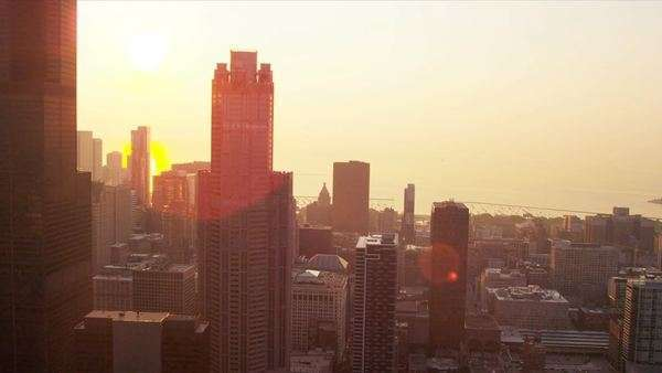 Aerial sunrise cityscape view of Chicago skyscrapers, Lake Michigan, Chicago, Illinois, USA, shot on RED EPIC Royalty-free stock video