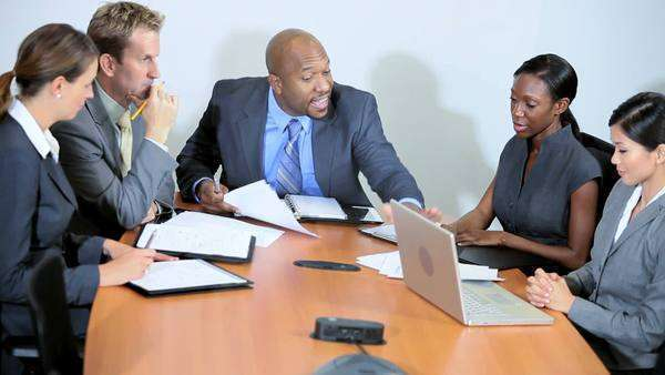 Male African American business executive demanding answers to bad news from multi ethnic business team Royalty-free stock video