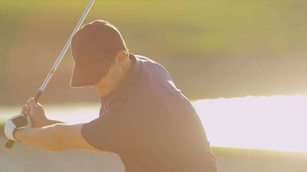 Close up Caucasian male golfer playing weekend round golf concentrating on hitting his ball out of sand bunker shot on RED EPIC Royalty-free stock video