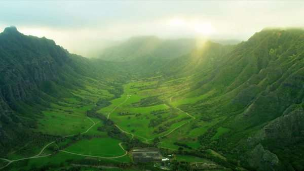 Aerial view of Kahana valley the windward side Oahu, Koolau mountain Range, Kahana Valley State Park, Hawaii, USA, RED EPIC Royalty-free stock video