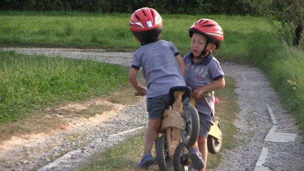 Boys on wooden bicycles, collision Royalty-free stock video