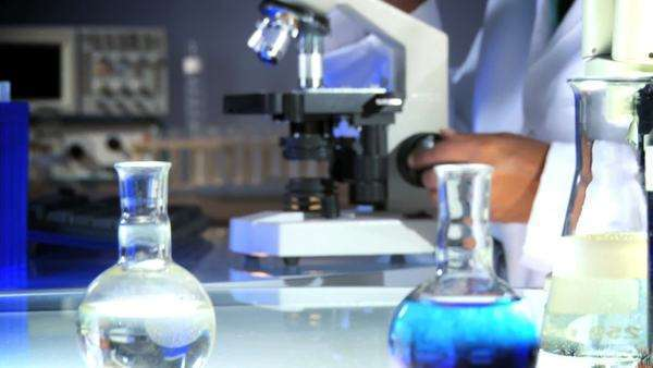 Medical professional looking through a microscope Royalty-free stock video