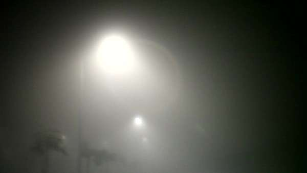 Focus on streetlights while travelling down dark foggy highway Royalty-free stock video