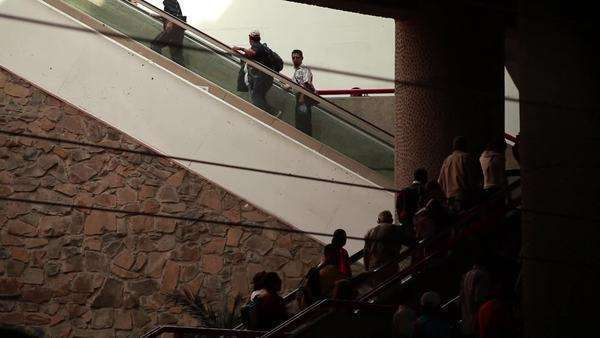 A crowd of people climbs up the stairs Royalty-free stock video