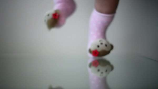 Baby's feet bouncing with monkey socks on Royalty-free stock video