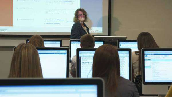 Wide shot of students in college computer lab Royalty-free stock video