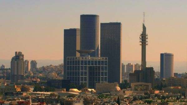 This is a shot of the Tel Aviv, Israel skyline looking east at about 9am. It is a very nice shot of the skyline. Shot on 02/18/2011. Panning shot. Royalty-free stock video