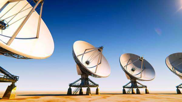 Satellite dishes rotating in front of the camera Royalty-free stock video