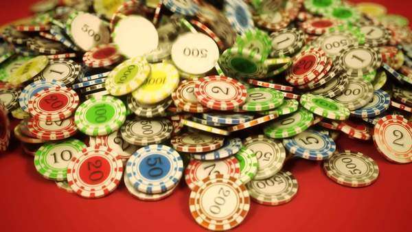 High quality 3D animation of gambling chips falling on the red background Royalty-free stock video