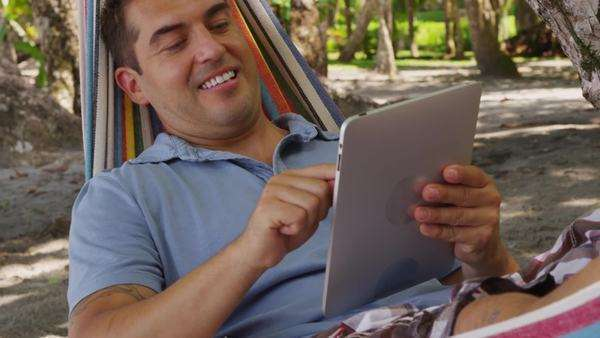 Man sitting in hammock using digital tablet, Costa Rica Royalty-free stock video