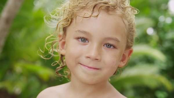 Portrait of young boy with tropical backdrop, Costa Rica Royalty-free stock video