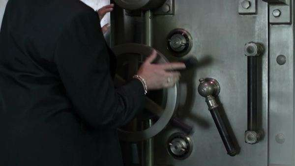Woman opens a large bank vault door.  Close up. Royalty-free stock video