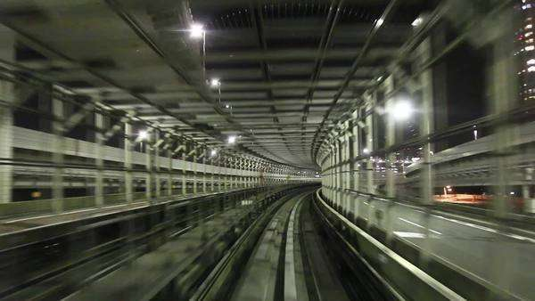 Driving with Tokyo metro at night, looking backwards in to the tunnel Royalty-free stock video