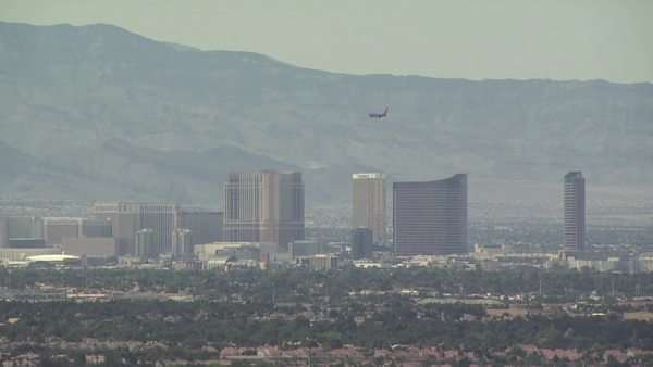 Silhouette of Airplane As It Approaches for A Landing With Mountains and Las Vegas City Scape As A Backdrop Royalty-free stock video