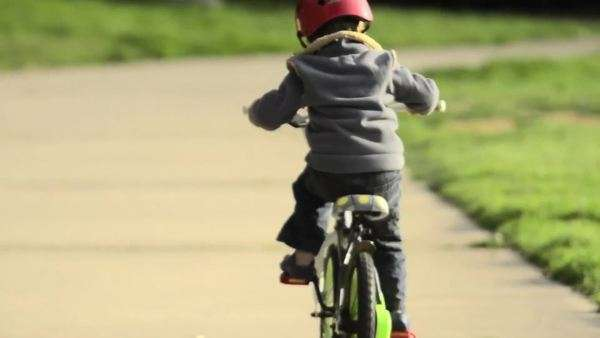 A boy riding a bike in a park Royalty-free stock video