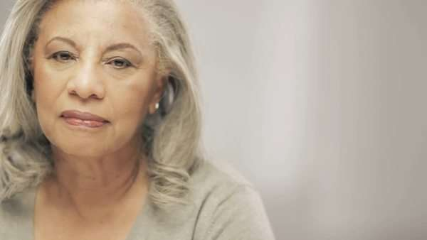 Older black woman with gray hair looking at camera Royalty-free stock video