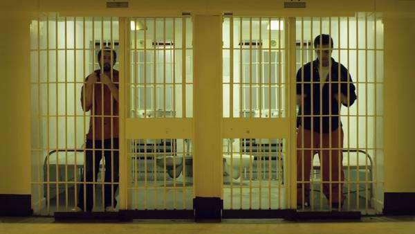 Two cells with bored prisoners doing time Royalty-free stock video