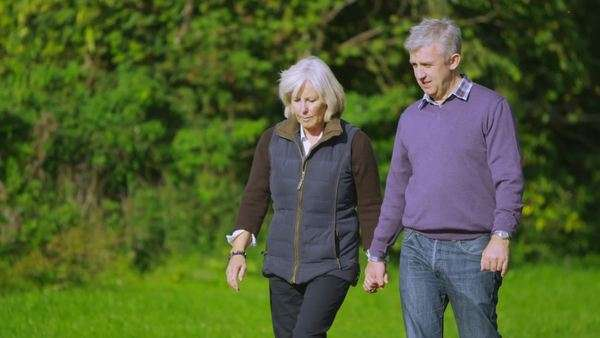 Happy mature couple walking in the countryside on an autumn day Royalty-free stock video