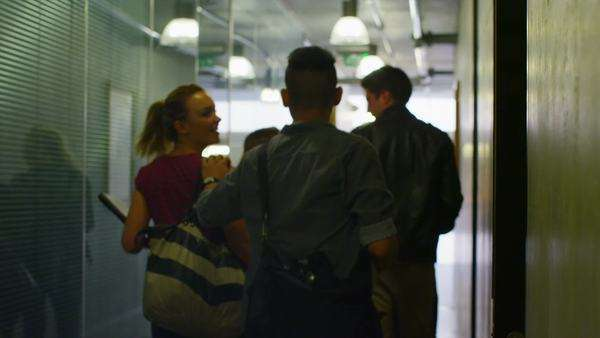Young student group walking through the hallway in modern college building Royalty-free stock video