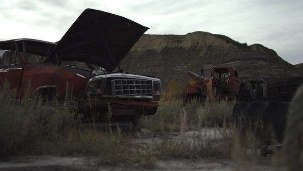 Tracking shot of abandoned vehicles in desert Royalty-free stock video