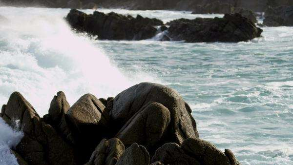 Powerful rolling surf crashing onto jagged rocks coastal waters shot on RED EPIC. Royalty-free stock video