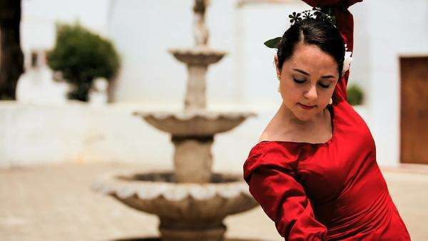 Beautiful lady dancing traditional Spanish flamenco in town square Seville. Royalty-free stock video
