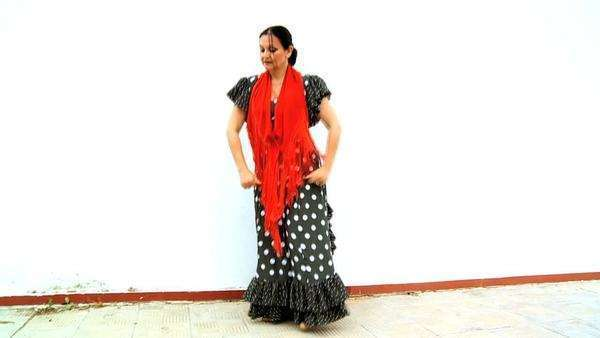 Female dancing traditional Spanish flamenco against white background, Seville. Royalty-free stock video