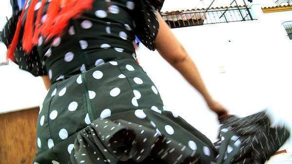 Female dancing traditional Spanish flamenco in town square, Seville, Spain 60FPS. Royalty-free stock video