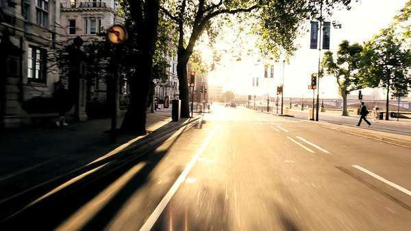 Point-of view driving through city streets with early morning commuters. Royalty-free stock video