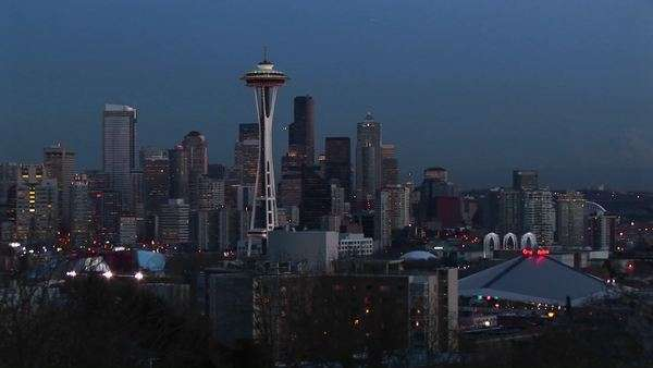 A look at Seattle's stunning skyline with its landmark Space Needle during the golden-hour. Royalty-free stock video