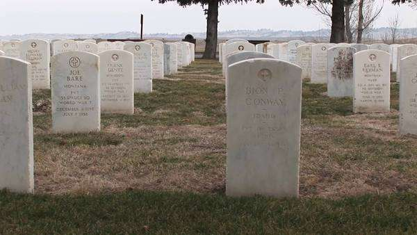 White marble headstones mark the graves of soldiers buried in a military cemetery. Royalty-free stock video