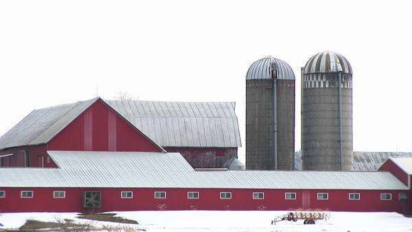 A fan turns on a red barn. Royalty-free stock video