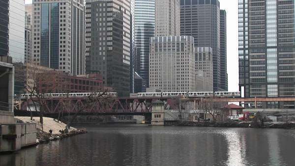 Elevated trains cross the river in Chicago. Royalty-free stock video