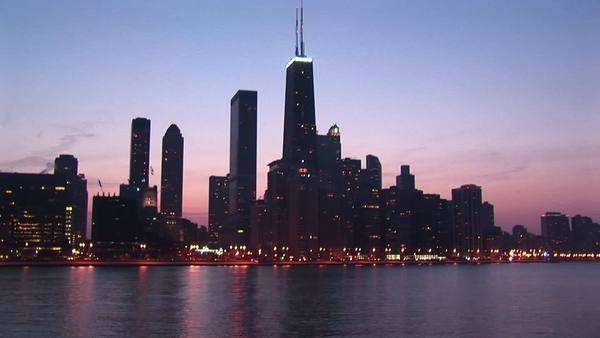 Chicago's Sears Tower dominates this skyline shot during golden-hour. Royalty-free stock video