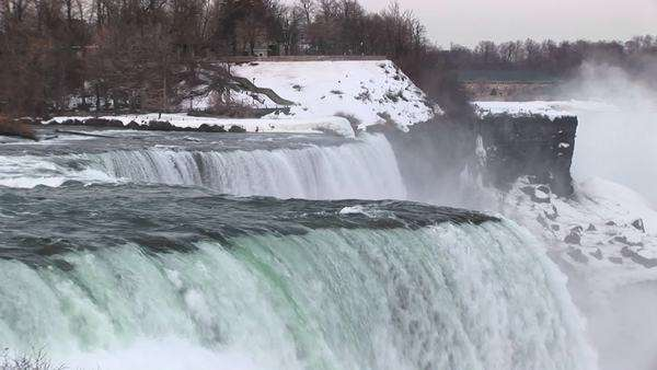 Water rushes over Niagara Falls in winter. Royalty-free stock video