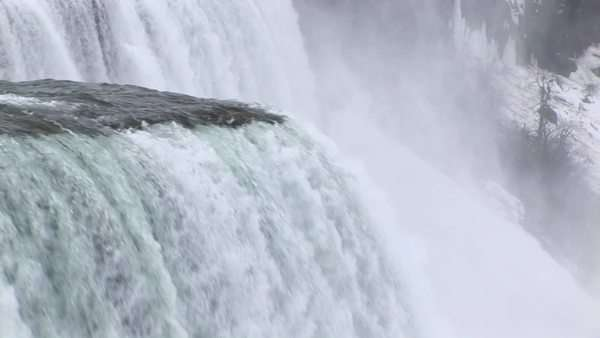 The camera pans from the edge of the Falls downward. Royalty-free stock video