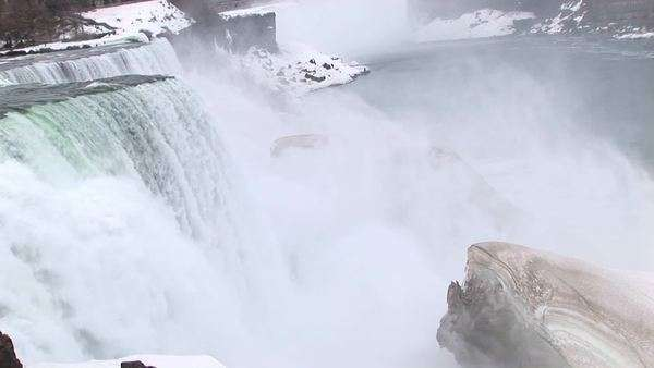 The camera looks down on Niagara Falls with a large ice chunk in the foreground. Royalty-free stock video
