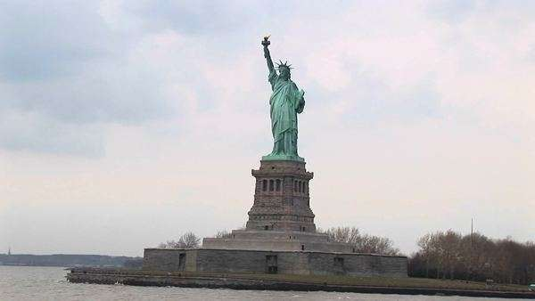The Statue of Liberty stands on Liberty Island in New York Harbor. Royalty-free stock video