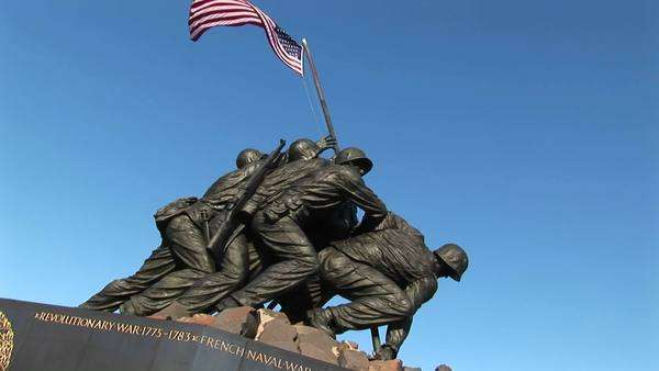 The American flag blows gently from the top of the Iwo Jima Marine Corps memorial. Royalty-free stock video