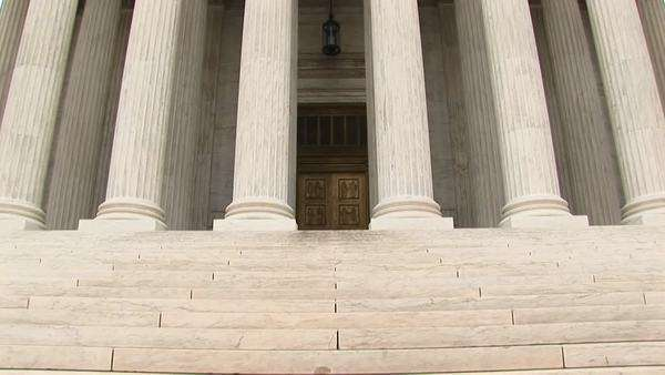 An upward pan of the front of  the Supreme Court. Royalty-free stock video