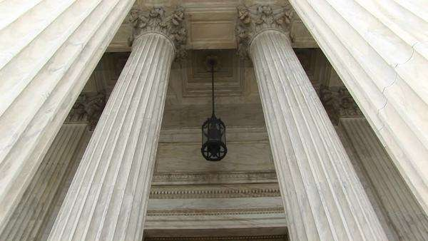 View of columns, a hanging lamp, and bronze doors at the west entrance of the Supreme Court. Royalty-free stock video
