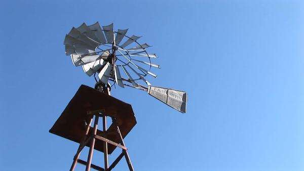 Worm's-eye-view of a windmill spinning in the breeze. Royalty-free stock video