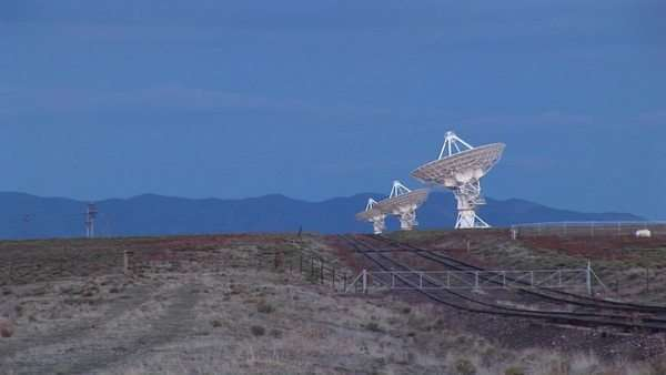 Long-shot of an array of radio antennas at the National Radio Astronomy Observatory in New Mexico. Royalty-free stock video
