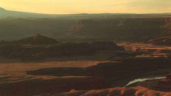Long shot of the Colorado River snaking through Canyonlands National Park from the Dead Horse Point Overlook. Royalty-free stock video
