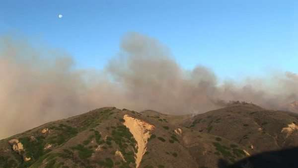 Long shot of  the wind carrying smoke from wildfires burning in southern California. Royalty-free stock video