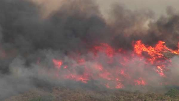 Long-shot of smoky wildfires burning in southern California. Royalty-free stock video