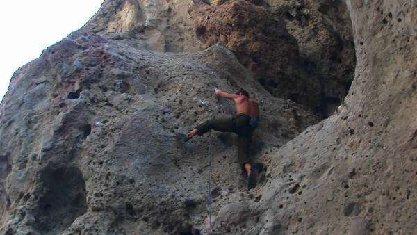 A rock climber reaches for new hand and foot holds. Royalty-free stock video
