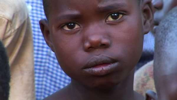Ugandan orphans stare into the camera. Royalty-free stock video